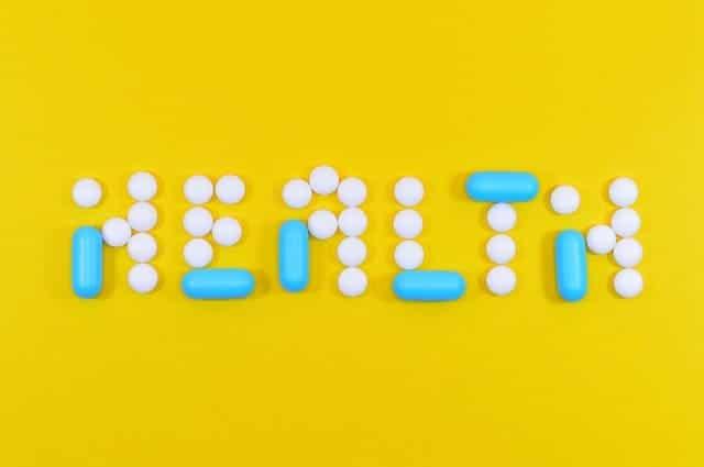 Escritura saludable hecha de tabletas y cápsulas.